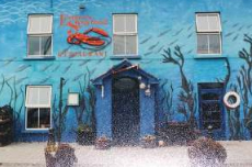 Eithnas with red lobster and blue facade