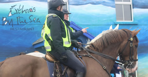 brown & grey horse with mounted police in front of Eithnas by the Sea Mullaghmore