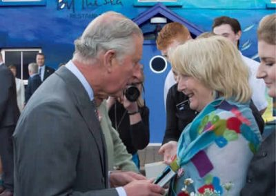 Prince Charles meeting Eithna outside Eithnas by the Sea Mullaghmore