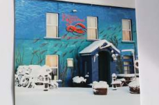 Eithnas blue building and red lobster